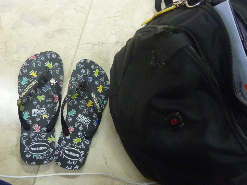 Cebu to Bacolod flight - my bag and Havaianas